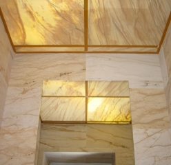 Backlit, flexible sandstone from YTTERSTONE® as wall and ceiling cladding