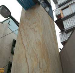 Flexible sandstone from YTTERSTONE® as facade cladding for a commercial building